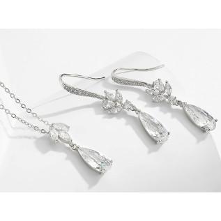 Boucles d'oreilles vintage sur dormeuses en laiton bronze composées de perles nacrées blanches, de perles et de cabochon